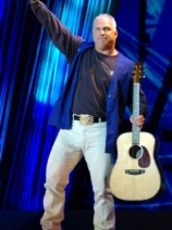 Garth Brooks, tipping his hat.